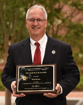Photo Brad Hunt with Krueger Plaque